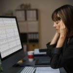 employee reading about workplace discrimination laws realizes she is a victim of workplace discrimination