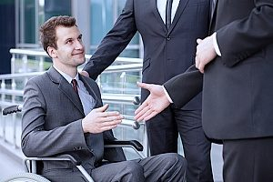 a man with a disability returning to work after being diagnosed with Parkinsons disease after speaking with an employment law attorney in case he faced disability discrimination