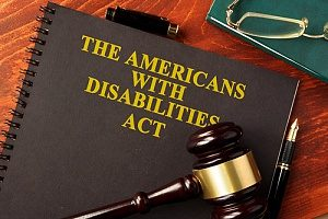 a book about the Americans with Disabilities Act along with a gavel owned by an ADA lawyer