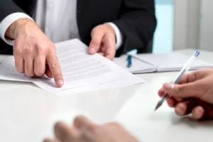 Employment law attorney guiding client through a settlement agreement for wrongful termination