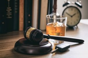 DUI Court gavel with alcohol in background