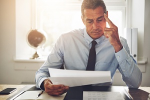a man looking at a breach of employment contract problem