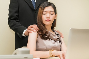 a woman and man experiencing an employer harassment situation