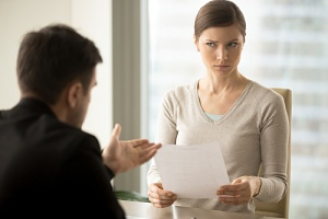 a woman looking at a breach of employment contract