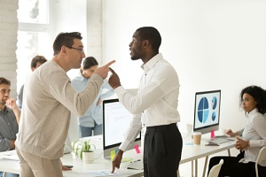 two men fighting over an employer discrimination problem