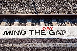 Mind the pay gap graffiti