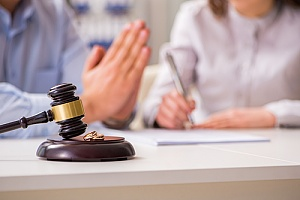 Hands pleading in a civil case