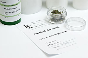 Medical marijuana with prescription bottle, container and lid.