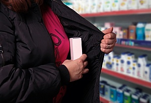 a woman shoplifting in a pharmacy
