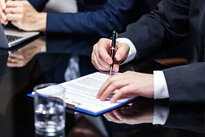 a person signing important cda or nda documents