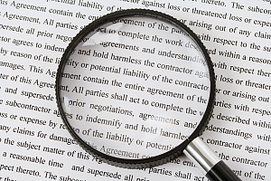 magnifying glass over a legal document to be ready carefully in a cda or nda