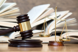 Gavel placed next to premises liability case information