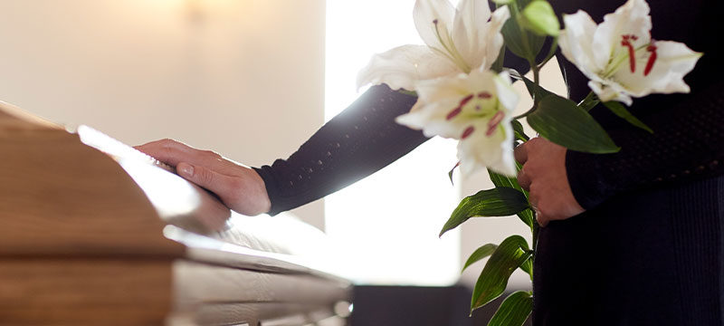placing flowers on a funeral for wrongful death
