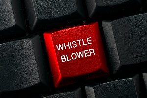 a black keyboard with a red button that says whistle blower on it