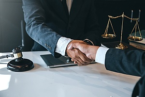 wage and hour dispute lawyer shaking hands with a client