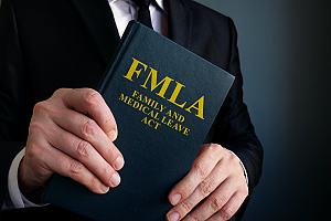 Attorney holding family and medical leave act document