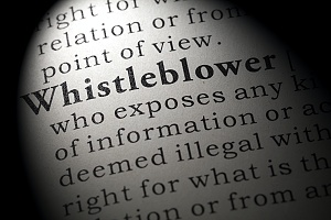 close up view of the definition of a whistleblower in a dictionary