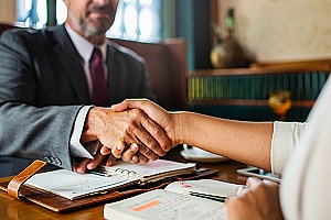 employment law lawyer shaking hands with a client