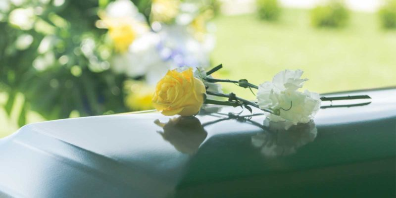 Flowers on casket at funeral
