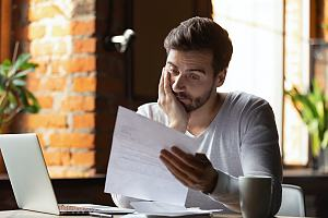 Worried person looking at finances