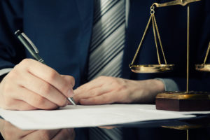 Wrongful death attorney writing notes