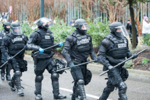 police officers put on extra equipment in case they have to use excessive force