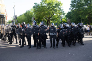 police protect themselves while monitoring protest about police brutality