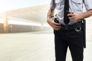 police officer keeps hand on holster in case he has to use excessive force
