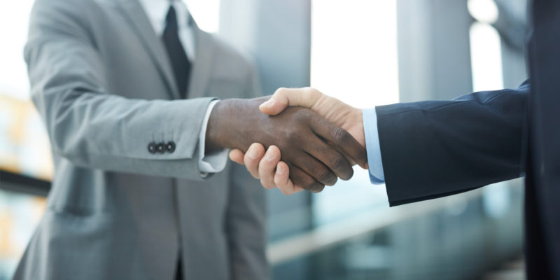 an attorney shaking hands after joining a board of directors