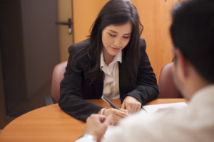 attorney explains the law regarding unlawful arrest to the client