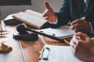 attorney speaks to the client regarding their unlawful arrest case