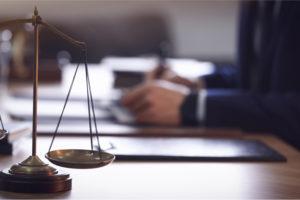 attorney write notes regarding the unlawful detainment trial