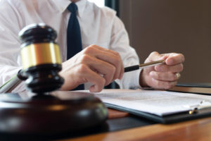lawyer talks to the client about their unlawful detainment experience
