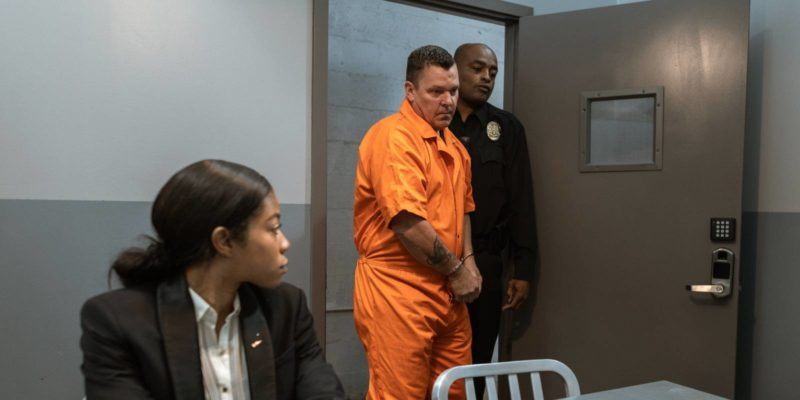 lawyer waits as client walks in before they talk about the clients unlawful arrest