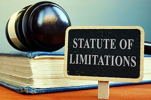 Book, gavel and Statute of limitations sign