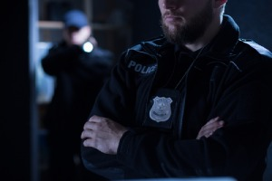 Close-up of police officers. When someone envisions unlawful detainment, they most often imagine a police officer