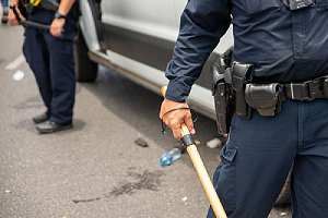 Police holding baton. The statute of limitations may not prevent you from bringing a case