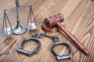 Law Scales, Judge's Gavel and Handcuffs