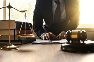 male lawyer working with calculator and wooden gavel