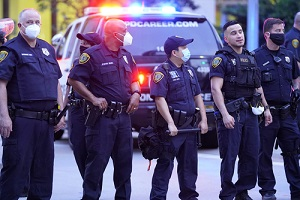 police officers patrolling a street in retaliation