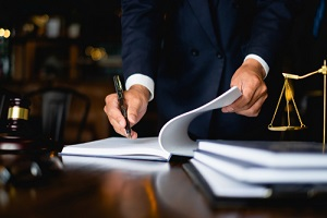 lawyer businessman working or reading lawbook in office