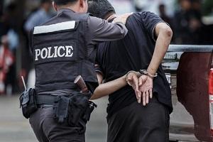 police officer arresting a protesting man