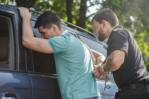 police officer is arresting young and irresponsible man Without A Warrant